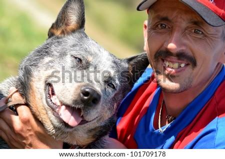 Australian Cattle Dog with man - stock photo