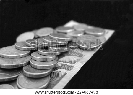 Australian Coins on a Bed of Dollars - stock photo