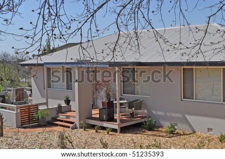 australian family house at autumn time - stock photo