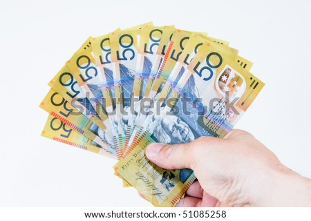 Australian fifty dollar notes in hand.