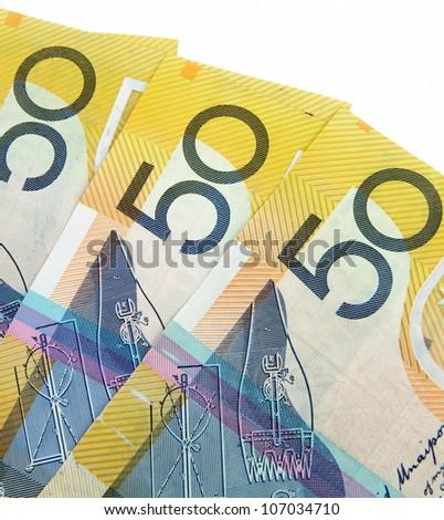 australian fifty dollars notes on white - stock photo