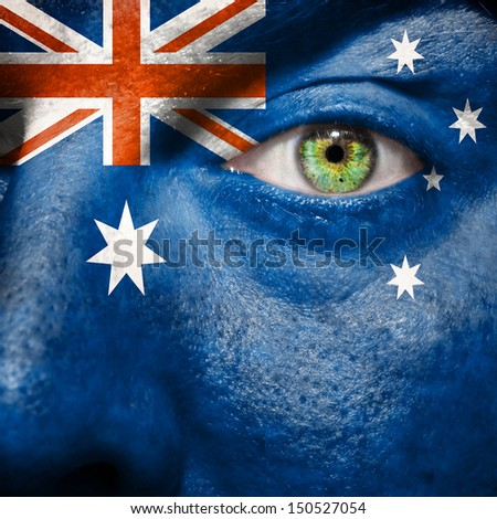 Australian flag painted on a man's face to support his country Australia - stock photo