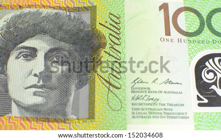 Australian green and gold  100 hundred dollar note, against a black background. - stock photo