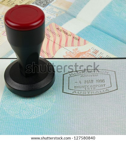 Australian immigration stamp and visa with a stamping tool - stock photo
