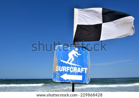 Australian Lifeguards Black and White Quartered Flag.Indicates the area where board riding and surfing is not permitted. - stock photo