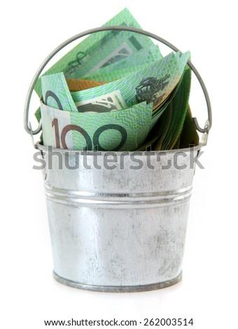 Australian Money - Aussie currency in a tin bucket - stock photo
