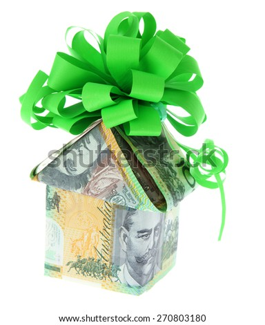 Australian Money - Aussie currency with gift bow - stock photo