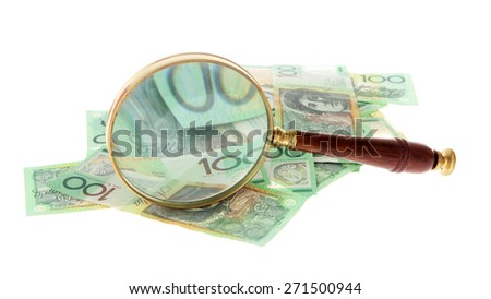 Australian Money - Aussie currency with magnifying glass