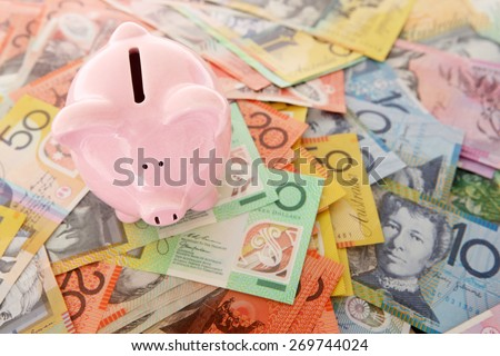 Australian Money - Aussie currency with piggy bank - stock photo