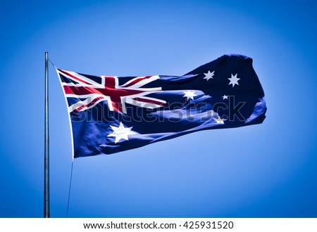 Australian National Flag blowing in the wind showing southern cross and union jack. - stock photo