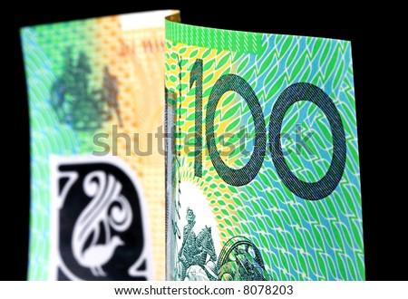 Australian one hundred dollar note isolated on black background. - stock photo