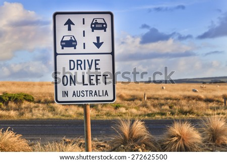 """Australian outback road sign """"drive on left in australia"""" as a reminder for overseas tourists about road safety on Great Ocean Road - stock photo"""