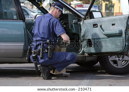 Australian Police officer at work on a stolen car...
