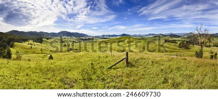 Australian rural agricultural area developed for cattle production - view over green grazed hills in cobark valley, NSW - stock photo