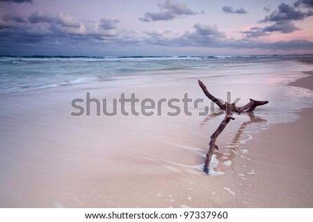 australian seascape at twilight (main beach, qld, australia) - stock photo