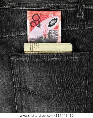 australian twenty dollars note and wallet in jeans pocket - stock photo
