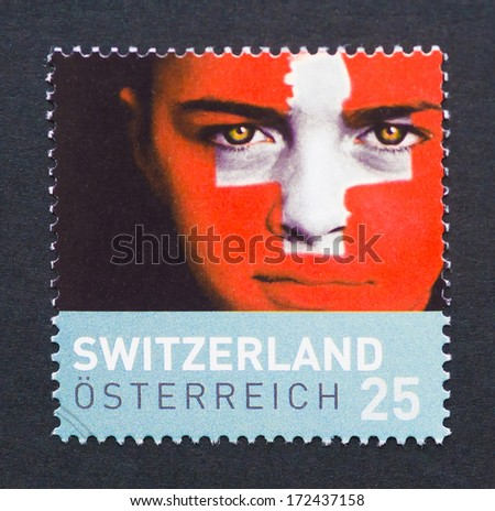 AUSTRIA - CIRCA 2008: a postage stamp printed in Austria commemorative of Euro 2008 Championship showing an image of a boy face painted with the colors of the Switzerland flag, circa 2008.