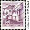 "AUSTRIA - CIRCA 1957: A stamp printed in Austria from the ""Buildings"" issue shows Old Courtyard, Morbisch, circa 1957. - stock photo"