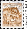 "AUSTRIA - CIRCA 1957: A stamp printed in Austria from the ""Buildings"" issue shows Old farmhouse, Pinzgau, circa 1957. - stock photo"