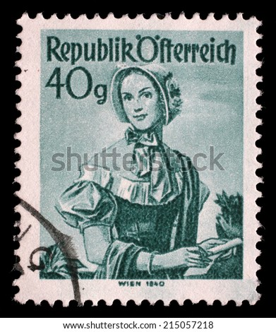 "AUSTRIA - CIRCA 1948: A stamp printed in Austria from the ""Provincial Costumes"" issue shows a woman from Vienna (1840), circa 1948. - stock photo"