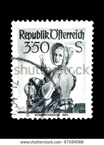 "AUSTRIA - CIRCA 1951: A stamp printed in Austria shows a woman in the Austrian national dress with the inscription ""Lower Austria, 1850"" from the series ""Costumes"", circa 1951"