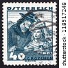 AUSTRIA - CIRCA 1929: a stamp printed in the Austria shows Couple from Tyrol, Regional Costume, circa 1929 - stock photo