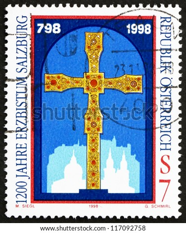 AUSTRIA - CIRCA 1998: a stamp printed in the Austria shows Golden Cross, 1200th Anniversary of Salzburg Archdiocese, circa 1998 - stock photo