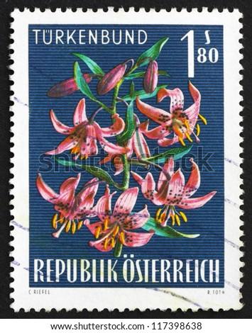 AUSTRIA - CIRCA 1966: a stamp printed in the Austria shows Turk's Cap Lily, Lilium Superbum, Alpine Flower, circa 1966 - stock photo