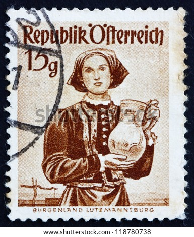 AUSTRIA - CIRCA 1948: a stamp printed in the Austria shows Woman from Burgenland, Lutzmannsburg, Regional Costume, circa 1948 - stock photo