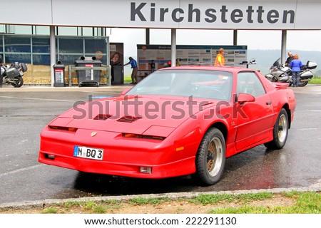 AUSTRIA - JULY 28, 2014: Retro sports car Pontiac Firebird at the interurban freeway. - stock photo