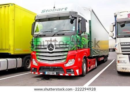 AUSTRIA - JULY 28, 2014: Semi-trailer truck Mercedes-Benz Actros at the interurban freeway. - stock photo