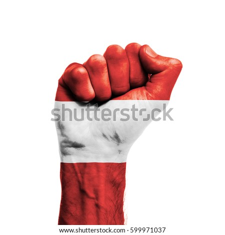 Austria national flag painted onto a male clenched fist. Strength, Power, Protest concept
