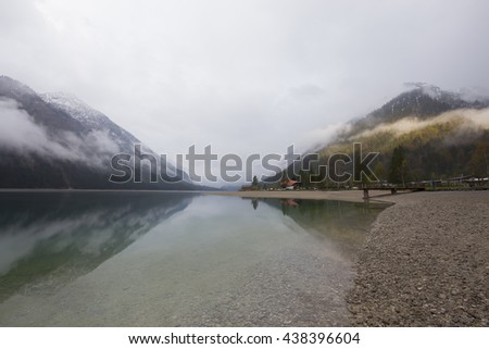 AUSTRIA - PLANSEE ; 01 MAY 2016 ,Landscape of Plansee lake and Alps mountains in winter, evening view, Tyrol, Austria