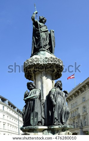 Austria, sculpture of Austria fountain and flag on Freyung square in Vienna
