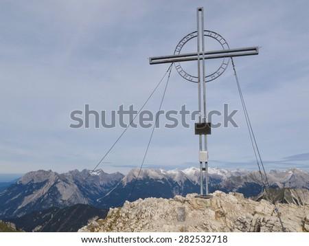 Austria, tyrolean alps, metallic mountain cross - stock photo