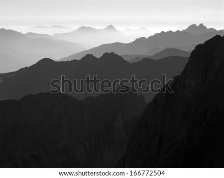 Austrian Alps, Italian Alps, Carnic Alps, morning haze in black and white - stock photo