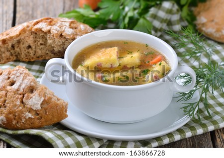 Austrian clear broth with salted sponge mixture, so called 'schoeberl', made of baked eggs and butter with ham or bacon  - stock photo