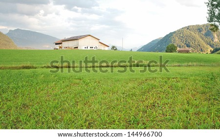 Austrian landscape - mountains and grass - stock photo