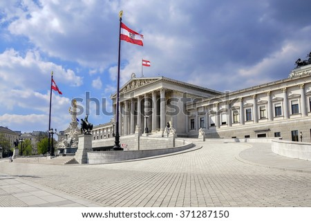 Austrian parliament building with famous Pallas Athena fountain and main entrance in Vienna, Austria - stock photo