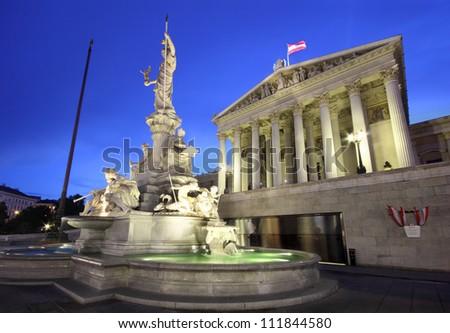 Austrian Parliament in Vienna - a beautiful European landmark at night - stock photo