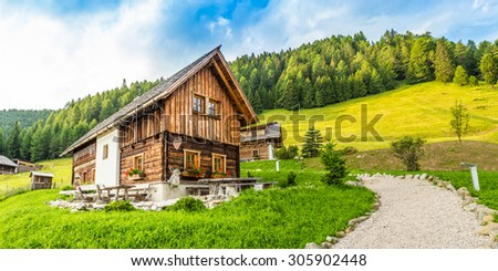 Austrian wooden chalet in Carinthia Alps - stock photo