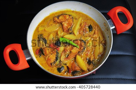 Authentic Bengali fish curry with potato, ginger and curry leaves