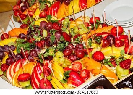 Authentic buffet, assorted fresh fruits, berries and citrus fruits. Morning atmospheric lighting, fashionable trendy spot soft focus. Preparation for design creative menu. - stock photo