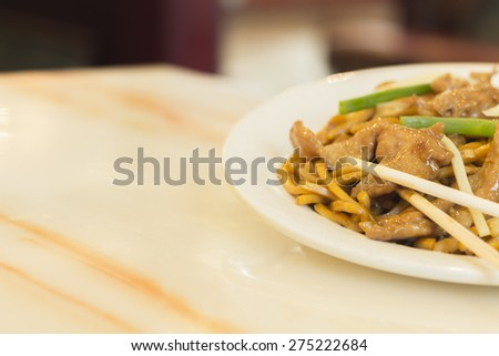 Authentic Chinese chicken lo mein noodles at a restaurant - stock photo