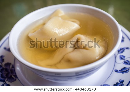 Authentic chinese food wonton soup on green table
