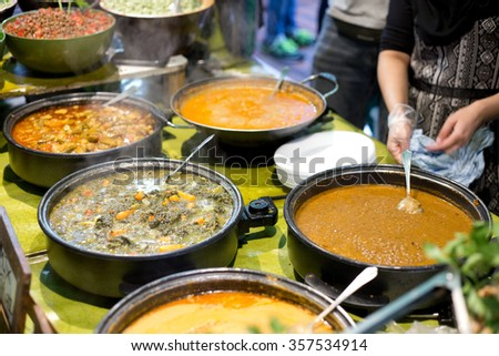 authentic indian cuisine on a buffet - stock photo