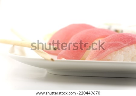 Authentic Japanese cuisine tuna sushi with california roll, wasabi, and ginger