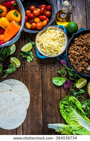 Authentic mexican tortillas ingredients on table. View from above, space for recipe. - stock photo