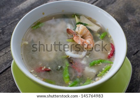 Authentic Tom Yum soup, with shrimp and squid.Famous Thai Thai Food.