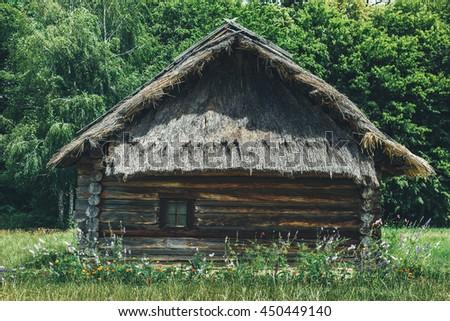 Authentic Ukrainian village house.A typical ukrainian antique house, in Pirogovo near Kiev - stock photo